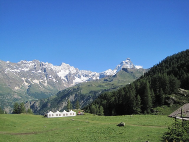 Tent and landscape, nature yoga, Yogagaia and hiking in the Alps